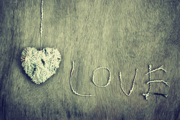 hearts shapes with wool texture over wooden textured background