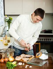 man cooking porbeagle