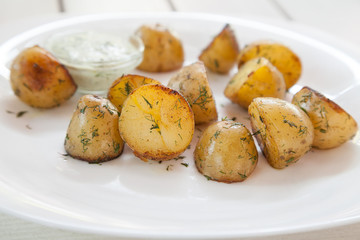 Plate with baked potatoes and dill