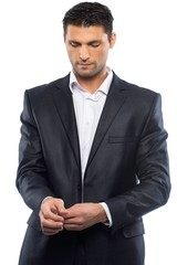 Handsome young man in black suit and white shirt