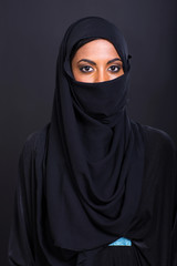 young muslim woman on black