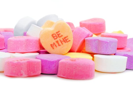 Pile of Valentines Day candies with BE MINE message