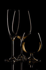 Champagne wine and whiskey glasses on dark background