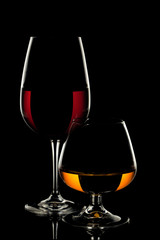 Wine Glass and Whiskey Glass on black background