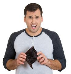 Closeup portrait of a broke man holding an empty wallet
