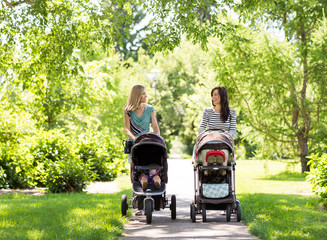 Obraz Mothers With Baby Carriages Walking In Park - fototapety do salonu