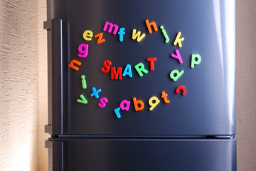 Word Smart spelled out using colorful magnetic letters