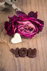 """the dried rose with chocolate inscription """"you"""" and hart"""