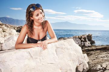 Young slim woman on beach portrait.