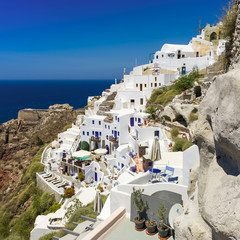 white houses with blue trim on the island of Santorini, Greece
