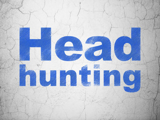 Business concept: Head Hunting on wall background