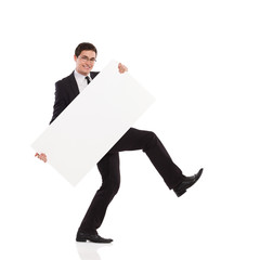 Young office worker walking with placard.