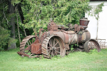 Old rusty farming tractor