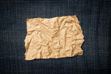 Crumpled paper ob blue jeans texture