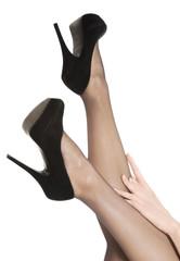 Beautiful long woman's legs in stockings and black high heels.
