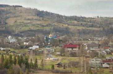 Ukrainian village in the valley of Carpathian mountains.