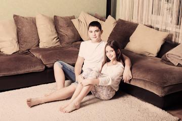 Teenage boy and girl at home