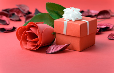 Red rose with gift box