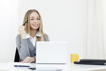 Business woman sitting at a desk office computer