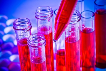 detail of test tubes with red liquid in laboratory