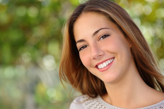 Beautiful white woman smile dental care concept