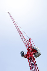 Close-up view of a red crane against sky
