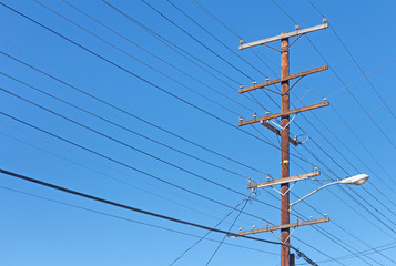Telephone utility pole, cables, clear blue sky