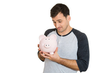 young successful, happy man, worker, holding piggy bank