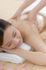 .A young woman enjoy massage.