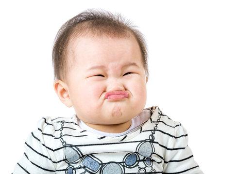 Asian baby girl make upset face