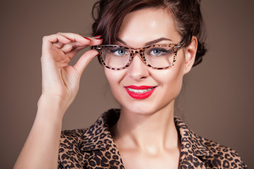 Close-up portrait of attractive caucasian woman in glasses