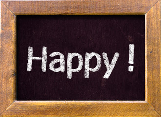 Happy ! written on blackboard blackboard