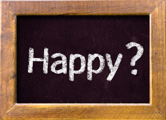 Happy ? written on blackboard blackboatd