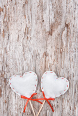 Valentine background  with textile hearts on old wood