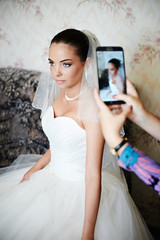 Photographing the bride on smartphone