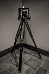Vintage Camera on Wooden Tripod