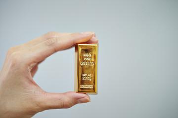 Hand holding golden bar