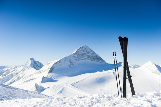 Skis in high mountains at sunny day