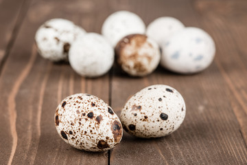 Quail eggs on a brown wooden table