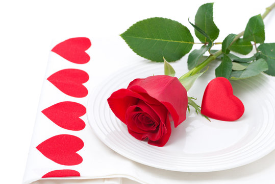Festive table setting with rose and heart