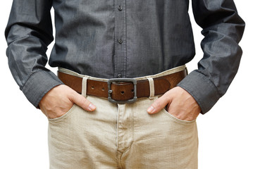 man with hands in pockets
