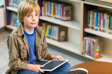 Boy With Digital Tablet In Library