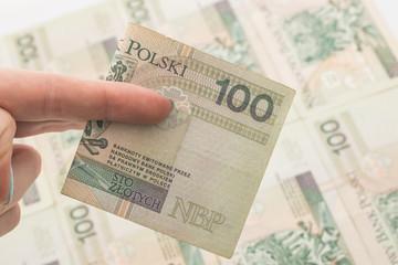 Obraz Łapówka - nacjonalizacja - ręka na pieniądzach - fototapety do salonu