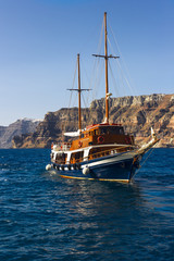 sailing ship on a background picturesque rocky shore