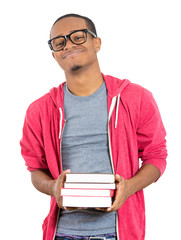 Excited, happy young student in glasses, holding books