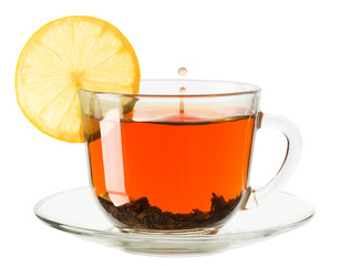 glass cup of tea with lemon on a white background