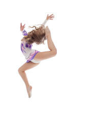 Graceful little artistic gymnast posing in jump