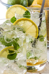 Closeup of cold lemon drink with mint