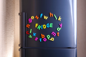 Word Fridge spelled out using colorful magnetic letters