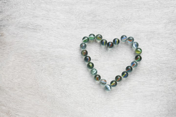 heart shape made from marbles